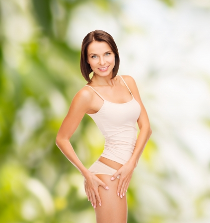health and beauty, eco, bio, nature concept - woman in cotton underwear showing slimming concept Stock Photo - 23317950