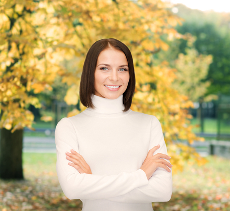 woman sweater: winter, people, happiness concept - smiling woman in white sweater
