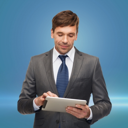 business, communication, modern technology and office concept - buisnessman with tablet pc photo