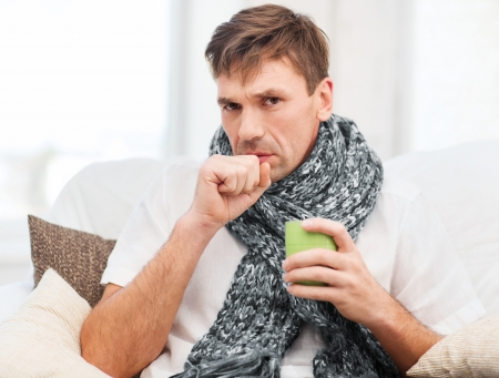 healthcare and medicine concept - ill man with flu at home Stock Photo - 23318025