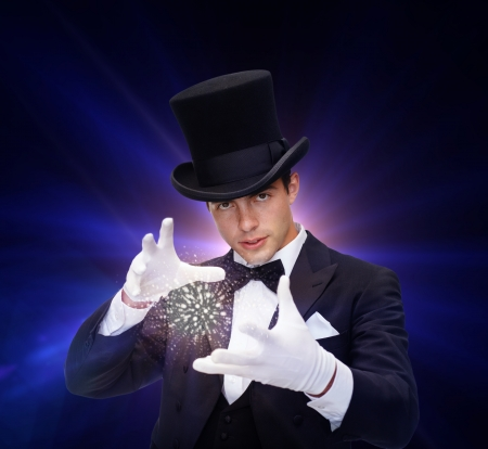 wizardry: magic, performance, circus, show concept - magician in top hat showing trick