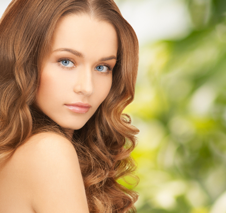 eco sensitive: health and beauty, eco, bio, nature concept - face of beautiful woman with long hair over green background Stock Photo