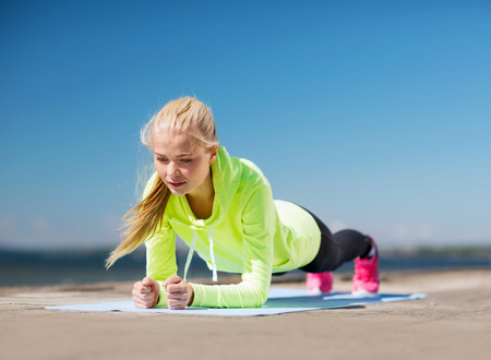 outdoor training: sport and lifestyle concept - woman doing sports outdoors Stock Photo