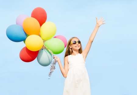 party balloons: summer holidays, celebration, family, children and people concept - happy girl with colorful balloons