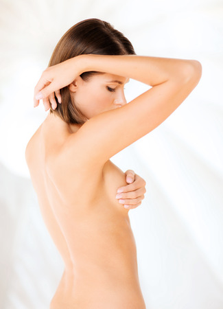 women breast: health, medicine, beauty concept - woman checking breast for signs of cancer Stock Photo