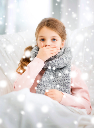 healthcare and medicine concept - ill girl with flu at home photo
