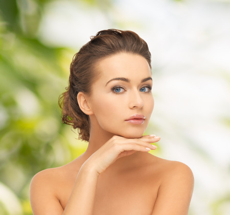 eco sensitive: health and beauty, green, eco, bio concept - face and hands of beautiful woman with updo (can be used as a template for jewelry) Stock Photo