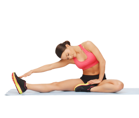 fitness, sport, training, gym and lifestyle concept - beautiful sporty woman doing exercise on the floor photo