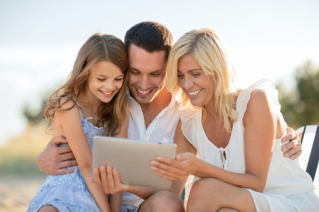 summer holidays, children and people concept - happy family with tablet pc taking picture photo