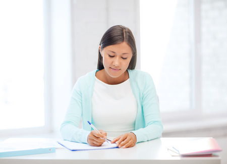 education, school and business concept - international student studying in college photo