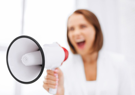 woman screaming: business and communication, bad boss concept - strict businesswoman shouting in megaphone in office