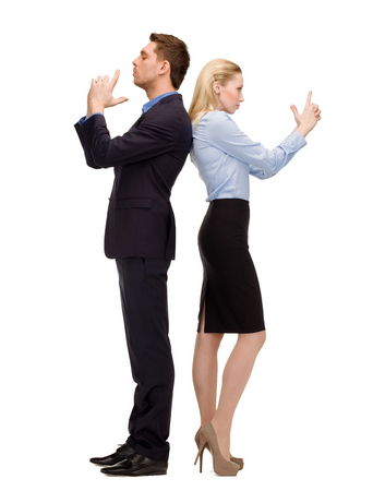 business, teamwork, secutiry, confidence concept - businesswoman and businessman with imaginary guns photo