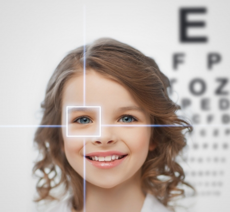 corrective: health, vision, medicine, laser correction, happy people concept - smiling pre-teen girl with optometric table or eyesight testing board