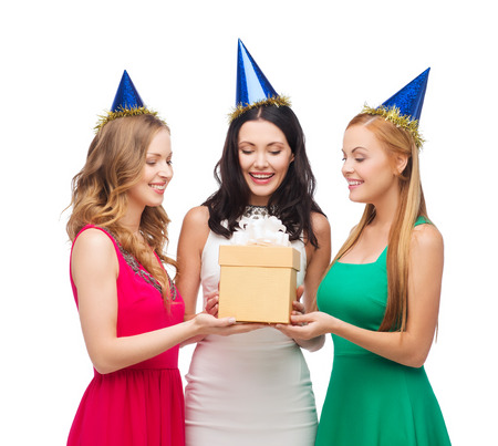 three gift boxes: celebration, friends, bachelorette party, birthday concept - three smiling women wearing blue hats with gift box