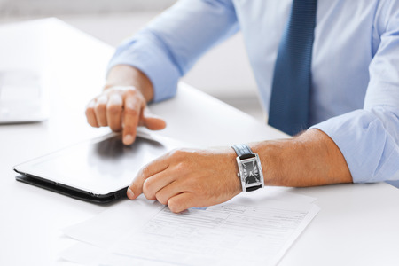 business, office, school and education concept - businessman with tablet pc in office photo