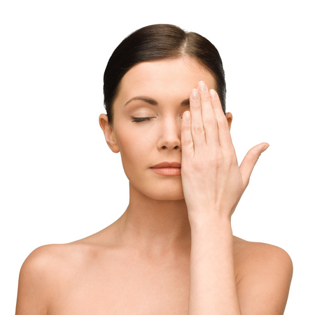 closed eye: beauty, spa and health concept - calm young woman covering half of face with hand