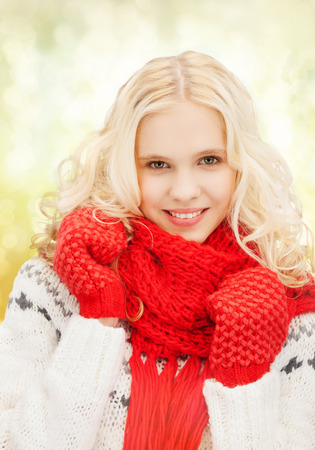 winter, christmas, xmas, x-mas, people, happiness concept - teenage girl in red mittens and scarf photo