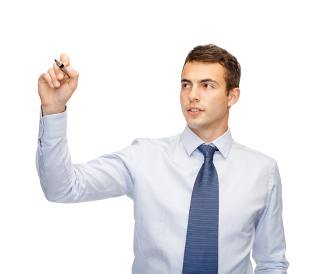 business and office concept - attractive buisnessman or teacher with marker writing or drawing something photo