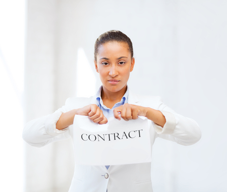 business and office, legal concept - african businesswoman tearing contract Stock Photo
