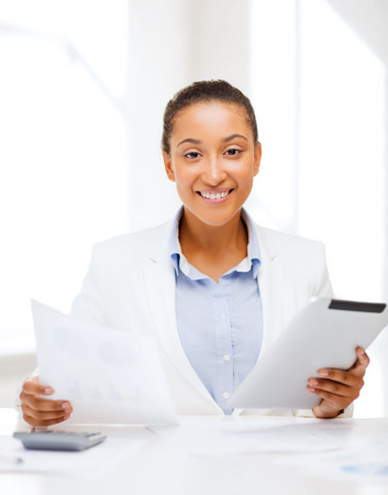 new job: office, business, technology and internet concept - businesswoman with tablet pc in office