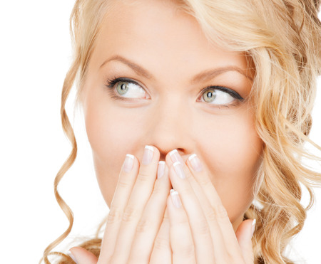 bad breath: health, beauty, business concept - face of beautiful woman covering her mouth Stock Photo