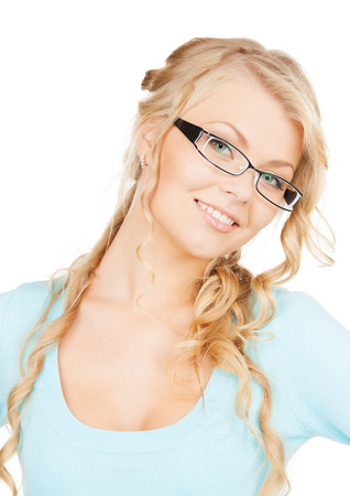 health and vision concept - close up of beautiful young woman wearing eyeglasses photo
