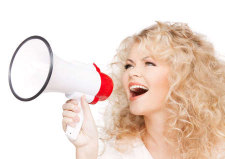 health and beauty concept - beautiful woman with long curly hair holding megaphone photo