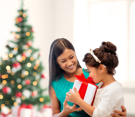holidays, presents, christmas, x-mas, birthday concept - happy mother and child girl with gift box Stock Photo - 24015252