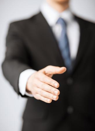business support: zakenmensen en kantoorconcept - zakenman met open hand klaar voor handshake Stockfoto