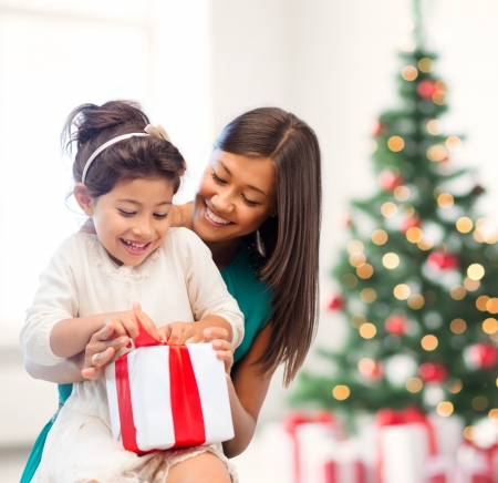 holidays, presents, christmas, x-mas, birthday concept - happy mother and child girl with gift box Stock Photo - 24014242