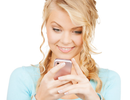 technology and internet concept - smiling woman with smartphone photo