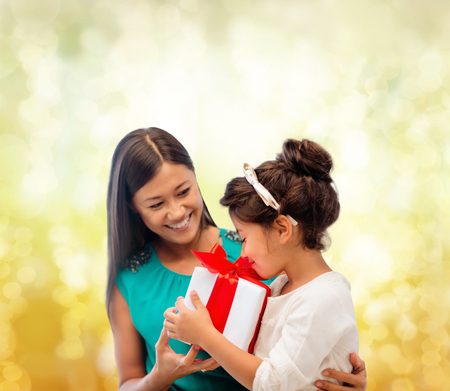 holidays, presents, christmas, x-mas, birthday concept - happy mother and child girl with gift box Stock Photo - 24013791