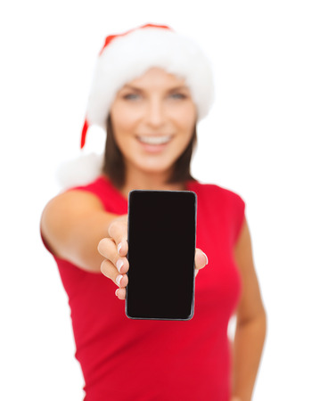 digi: christmas, x-mas, electronics and gadget concept - smiling woman in santa helper hat with blank screen smartphone