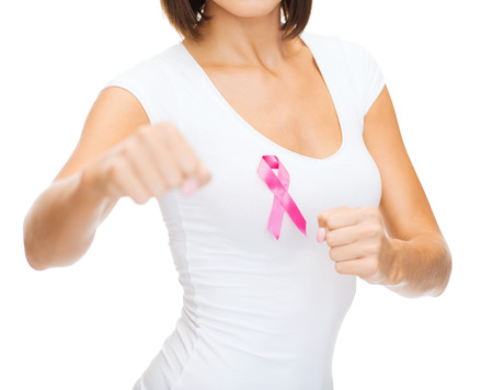 young girls breast: healthcare and medicine concept - woman in blank t-shirt with pink breast cancer awareness ribbon