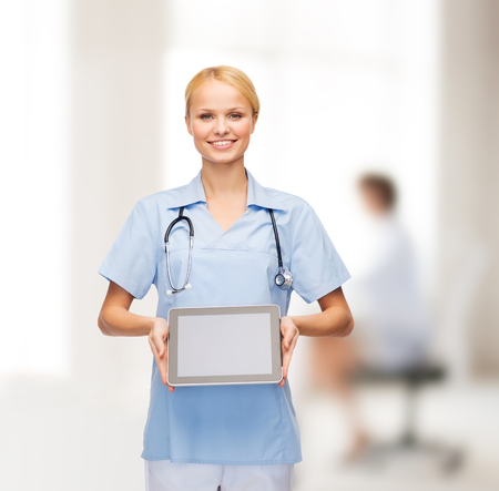 healthcare, medicine and technology concept - smiling female doctor or nurse with tablet pc computer photo
