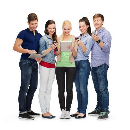 university application: education and modern technology concept - smiling students using smartphones and tablet pc