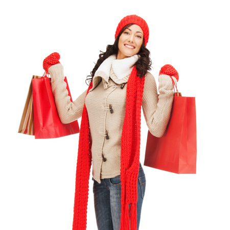 retail and sale concept - full-length picture of happy woman in winter clothes with shopping bags photo