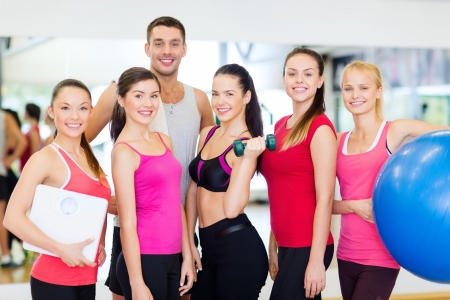 fitness, sport, training, gym and lifestyle concept - group of smiling people in the gym photo