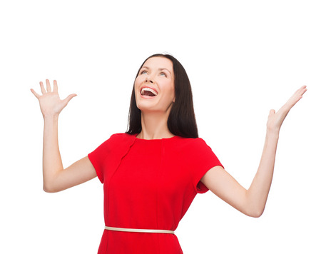 woman looking up: happiness and people concept - smiling young woman in red dress with hands up