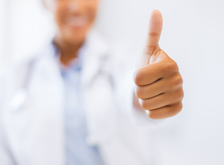 health and medicine concept - close up of female doctor hand showing thumbs up Stock Photo - 24072360