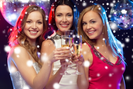bachelorette party: new year, celebration, friends, bachelorette party, birthday concept - three beautiful woman in evening dresses with champagne glasses Stock Photo