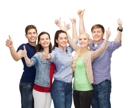 thumbs up group: education and people concept - group of smiling students standing and showing thumbs up
