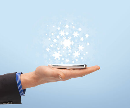 new technology: new technology and business - close up of man hand with smartphone Stock Photo