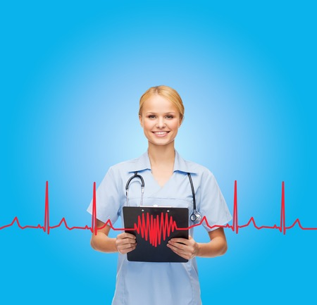 healthcare and medicine concept - smiling female doctor or nurse with stethoscope and clipboard photo