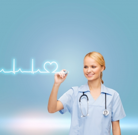 healthcare, medical and technology - young doctor or nurse drawing cardiogram