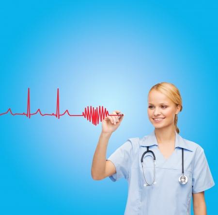 electrocardiograma: atención sanitaria, médico y la tecnología - joven médico o enfermera dibujo cardiograma