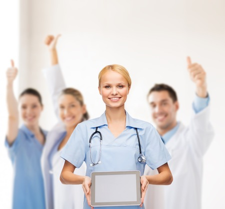 new medicine: healthcare, medicine and technology concept - smiling female doctor or nurse with tablet pc computer