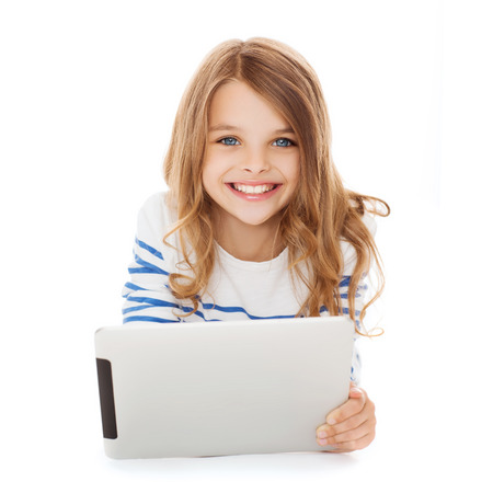 child studying: education, technology and internet concept - smiling little student girl with tablet pc computer Stock Photo