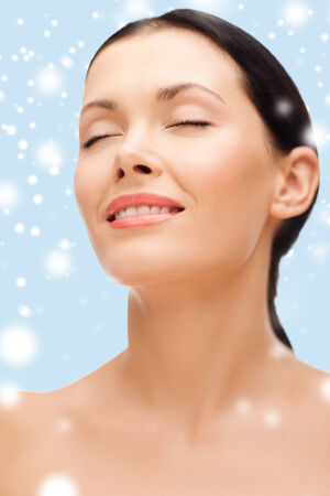 beauty, spa and health concept - smiling young woman with closed eyes photo