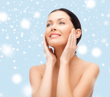 beauty, spa and health concept - smiling young woman photo